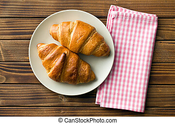top view of croissants on plate