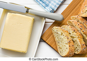 cube of butter with sliced bread