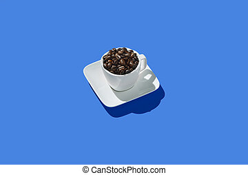 Top view of Cup of coffee on blue background