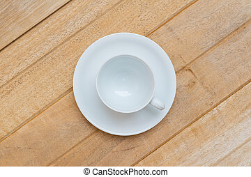 Top view of cup of white coffee on wood background
