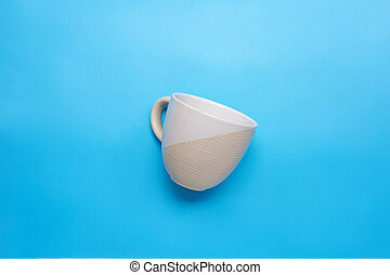 Top view of cup on blue background.