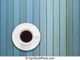 Top view of cup on blue wooden background