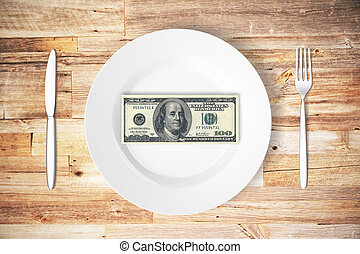 Cash concept - Top view of cutlery and plate with dollar...