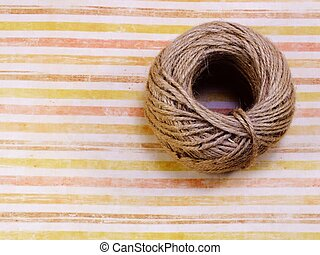 top view of decorative hemp rope roll with space copy background