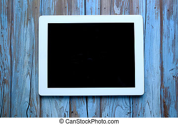 top view of digital tablet on wooden background.