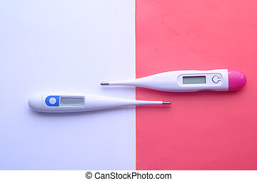 top view of digital thermometer on color background