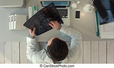 Top view of Doctor interpreting scan of the brain