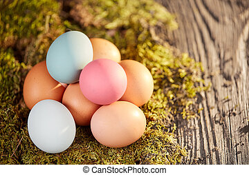 Top view of easter eggs on old wooden table