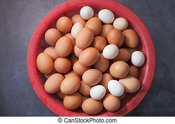 top view of eggs in a bowl on table