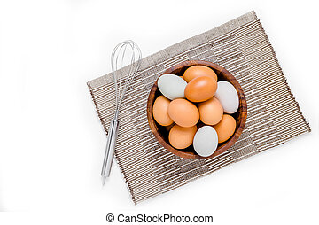 top view of eggs in bowl on white background.