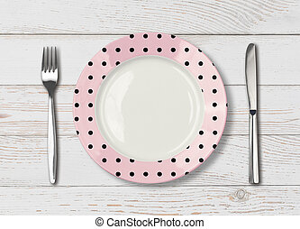 Top view of empty pink polka dot dish on wood table - empty...