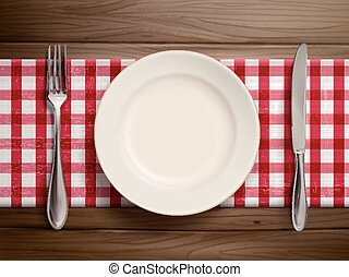 top view of empty plate with spoon and knife placed on...