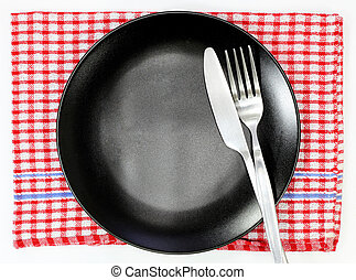 top view of empty plate with spoon and knife placed on table