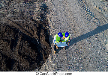 Top view of engineers at construction site