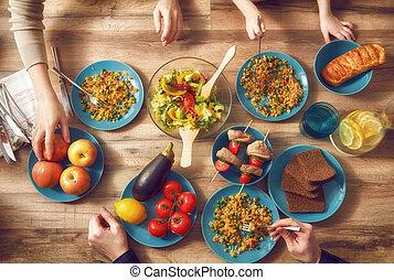 Enjoying family dinner - Top view of family having dinner...
