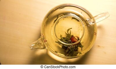 Top view of fast brewing green tea in shape of opening flower