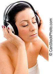 top view of young female enjoying music with white background