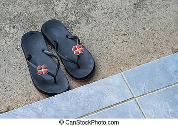 Top view of female sandals on the cement floor.,