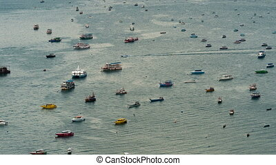 Top view of floating many ships and boats in the sea. Time Lapse. Thailand. Pattaya