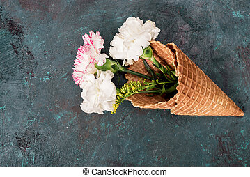 top view of flowers in sugar cones laying on stone table, still life