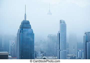 Top view of foggy Kuala Lumpur city skyline in the morning .