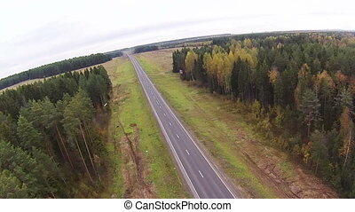 Top view of forest and passing highway