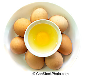 Top view of fresh eggs in bowl on white background