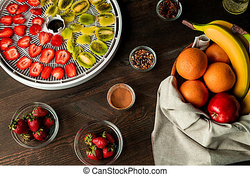 Top view of fresh fruit and spice assortment on wooden kitchen table