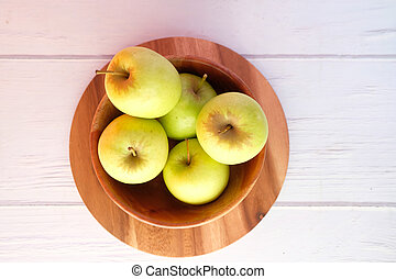 top view of fresh green apple on wooden background