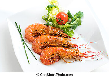 Top view of fresh grilled jumbo prawns with green salad. -...