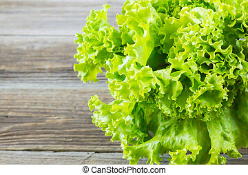 Top view of fresh Lettuce on wooden background