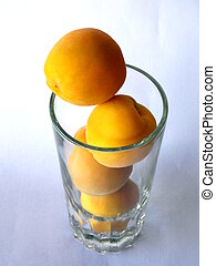 Top view of fresh peaches on a glass