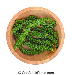 top view of fresh pepper seeds in wooden bowl isolated on white
