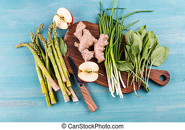 Top view of fresh seasonal vegetables on rustic wooden background