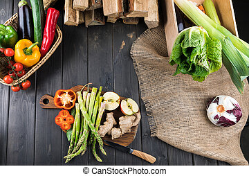 Top view of fresh vegetables on rustic wooden background