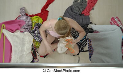 Top view of frustrated teenage girl sitting on the floor in...