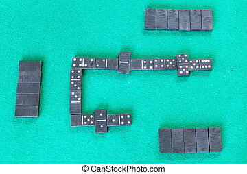 gameplay of dominoes board game with black tiles - top view ...
