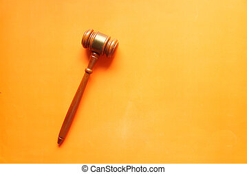 Top view of gavel on orange background