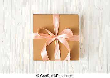 Top view of Gift box on white wood background.