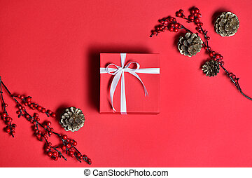 Top view of gift box with Christmas decor on red background