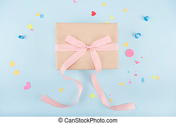 top view of gift box with ribbon and confetti mock-up, birthday party