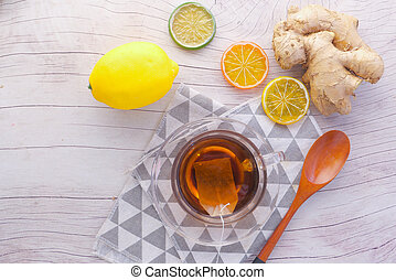 Top view of ginger tea on wooden background.