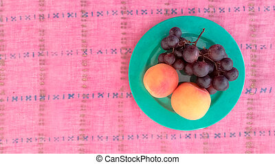 Top View of Grapes With Apricots in a Plate