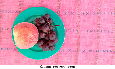 Top View of Grapes With Peach in a Plate