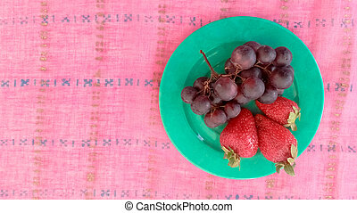 Top View of Grapes With Strawberries in a Plate