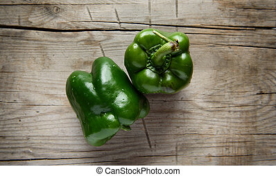 top view of green bell pepper on wooden table
