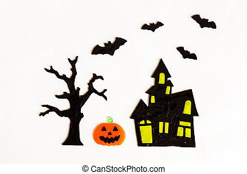 Top view of Halloween crafts, house, bat, tree on white background with copy space for text. halloween concept. Flat lay, overhead
