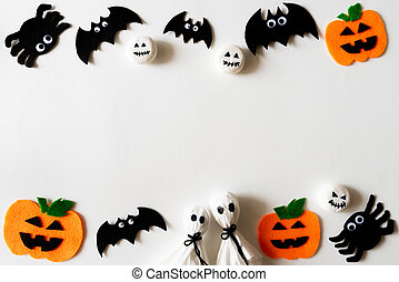 Top view of Halloween crafts, orange pumpkin, ghost and spide on white background with copy space for text. halloween concept.