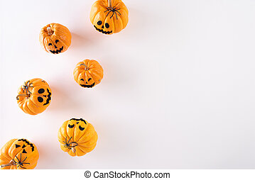 Top view of Halloween crafts, orange pumpkin, ghost on white background with copy space for text. halloween concept.