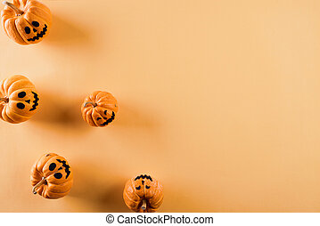 Top view of Halloween crafts, orange pumpkin on orange background with copy space for text. halloween concept.